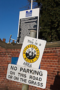 A neighbourhood watch sign outside the front gates to a prison. HMP/YOI Askham Grange is a women's open prison serving the Yorkshire area with a capacity of 128 women. It has extensive education, training and mother and Baby facilities.