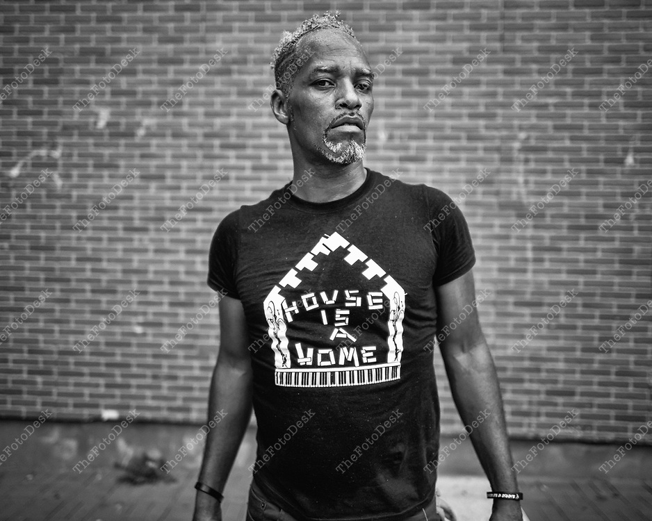 """NEWARK, NEW JERSEY:  performing artist Malik Versatility, 49 of Newark,  poses for a portrait and interview during the weekly Block Party on Edison Plaice in Newark, NJ on Friday, July 16, 2021 """"house music will hit your system in a venting situation.""""- Versatility said.(Brian B Price/TheFotodesk)."""