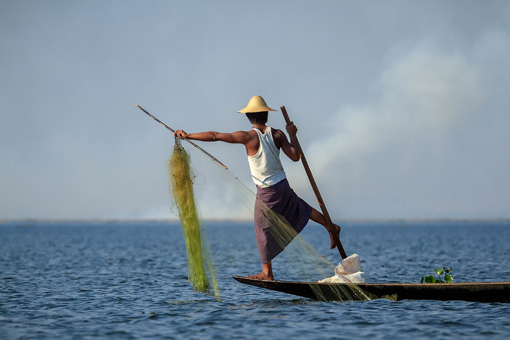 One of the famous leg rowers of Lake Inle at work