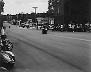 Motorcycle street drag races through downtown Boley, Oklahoma.