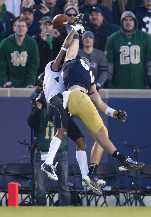 November 17, 2012:  Notre Dame tight end Tyler Eifert (80) goes up for a pass during NCAA Football game action between the Notre Dame Fighting Irish and the Wake Forest Demon Deacons at Notre Dame Stadium in South Bend, Indiana.  Notre Dame defeated Wake Forest 38-0.