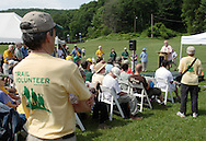 Bear Mountain, New York - People listen to a speaker at National Trails Day on the Appalachian Trail at Bear Mountain on June 5, 2010. A ceremony and hike celebrated the reconstruction of this original section of the Appalachian Trail.