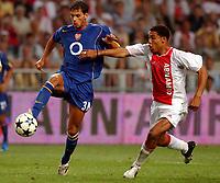 Fotball<br /> Treningskamper <br /> 01.08.2004<br /> Foto: SBI/Digitalsport<br /> NORWAY ONLY<br /> <br /> Ajax v Arsenal<br /> <br /> Ajax's Nigel de Jong and Arsenal's Jeremie Aliadiere
