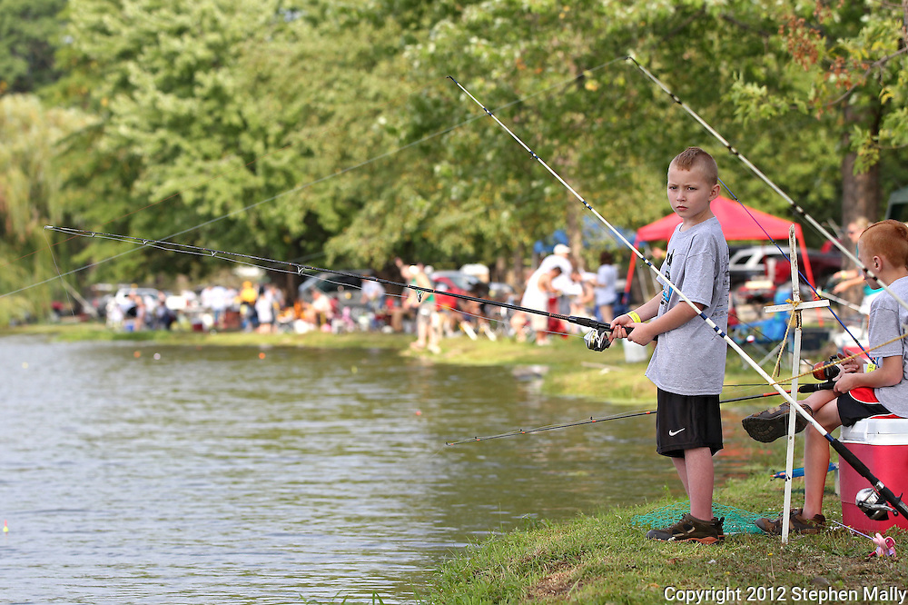 Noah Turpin, 10, of Cedar Rapids, keeps a close eye on the water during the 10th annual Boys & Girls Clubs of Cedar Rapids Fish-O-Rama at Robbins Lake in Cedar Rapids on Saturday, August 4, 2012. Organizers expected 1,200-1,500 participants in the weekend event. There were 426 prizes available to people who caught tagged fish. Prizes included a Toyota truck, boat, TVs, grills, bicycles, and gift certificates.