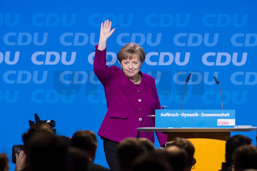 26 FEB 2018, BERLIN/GERMANY:<br /> Angela Merkel, CDU, Bundeskanzlerin, nimmt nach ihrer Rede den Applaus der Delegierten entgegen, CDU Bundesparteitag, Station Berlin<br /> IMAGE: 20180226-01-076<br /> KEYWORDS: Party Congress, Parteitag