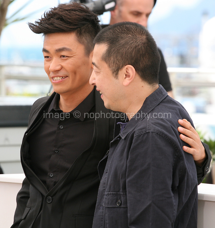 Actor Baoqiang Wang and Director Jia Zhangke at the Tian Zhu Ding (A Touch Of Sin) film photocall at the Cannes Film Festival 17th May 2013