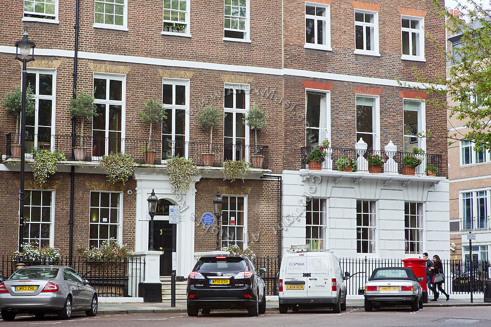 A couple is walking past  14 Manchester Square (Dabaiba HQ) in central London, United Kingdom.<br /> <br /> CREDIT: Alex Masi for The Wall Street Journal<br /> CHESTERTON<br /> <br /> The name of London real-estate agency Chesterton Humberts exudes English affluence. But in early 2011, as Libya was engulfed in revolution, a substantial stake in the firm was quietly acquired by the wealthy family of a longtime lieutenant to Moammar Gadhafi, according to a person with direct knowledge of the investment.