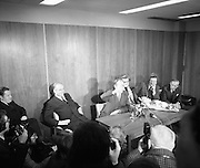 Dr Tiede Herrema Leaves Dublin.   (J87)..1975..08.11.1975..11.08.1975..8th November 1975..After his ordeal at the hands of a kidnap gang led by Eddie Gallagher,Dr Tiede Herrema held a press conference prior to his departure to his home in Holland. Mr herrema accompanied by his wife, Elisabeth,thanked the Irish people for their prayers and well wishes whilst he was held captive. Dr and Mrs Herrema were made honorary Irish Citizens and he was made Freeman Of Limerick in recognition of his ordeal..Image of Dr Herrema displaying a bullet given to him by his kidnapper, Eddie Gallagher, during the press conference.