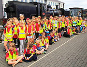 Primary school children group educational visit  heritage railway, Porthmadog, Gwynedd, north west Wales, UK