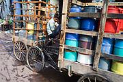 A boy delivering water in coloured buckets, Sitaram Bazar, Old Delhi, India
