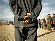The crowd is overlooked by a Mongolian policeman armed with an electric shocker.<br /> <br /> Eagle Hunting festival in Western Mongolia, in the province of Bayan Olgii. Mongolian and Kazak eagle hunters come to compete for 2 days at this yearly gathering. Mongolia