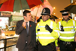 © Licensed to London News Pictures. 03/11/2015. Alum Rock, Birmingham, UK. Shadow Home Secretary ANDY BURNHAM visiting Alum Rock in Birmingham to launch the Labour Policy on Policing. Pictured from left to right, ANDY BURNHAM, Sgt IFTI ALI, Inspector CHRIS SMITH. Photo credit : Dave Warren/LNP