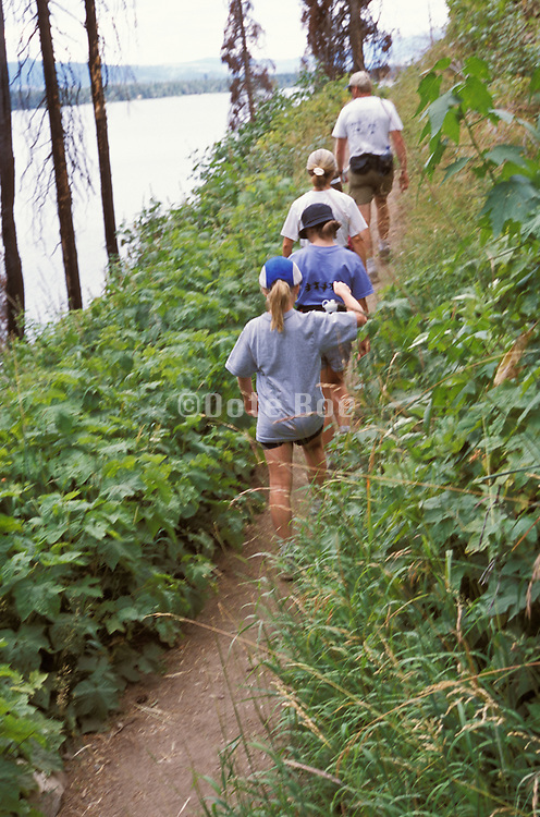 4 people hiking single file