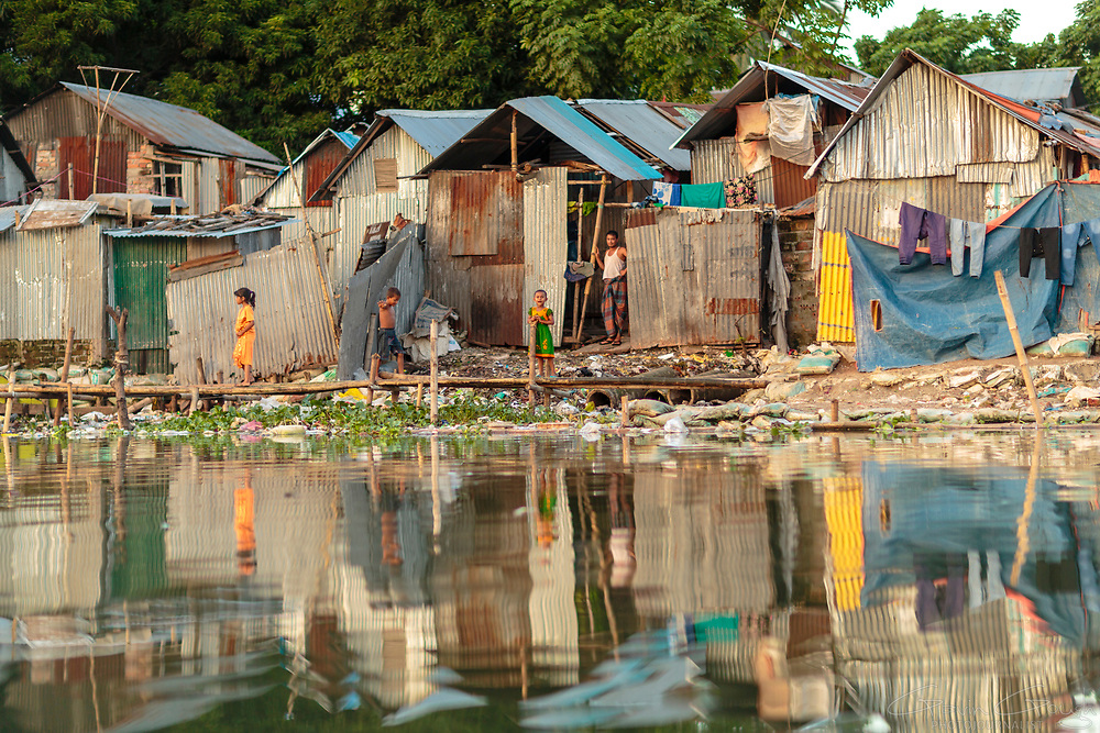"Dwellings alongside the waterfront in the Korail ""slum"" district"