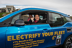 Pictured: Ruth Davidson and Maurice Golden<br /> Scottish Conservative leader Ruth Davidson launched the party's environment paper today in Edinburgh.  As part of Scottish Environment Week, she was joined by shadow environment secretary Maurice Golden in driving an electric BMW i3 car<br /> <br /> Ger Harley | EEm 22 February 2017