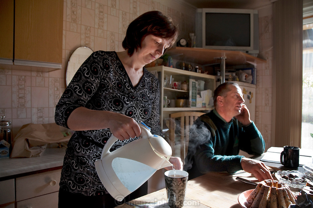 Ilona Radzins, the beekeeper's wife, makes tea for guests and shares her family's honey, drizzled on a dense slice of dark sour rye bread in their cozy kitchen overlooking the fruit trees and sauna house in Vecpiebalga, Latvia. (From the book What I Eat: Around the World in 80 Diets.)
