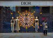 Masked shopper waiting outside the Dior store in London's Bond Street on the last day before the second national coronavirus lockdown on 4th November 2020 in London, United Kingdom. The new national lockdown is a huge blow to the economy and for individuals who were already struggling, as Covid-19 restrictions are put in place until 2nd December across England, with all non-essential businesses closed.