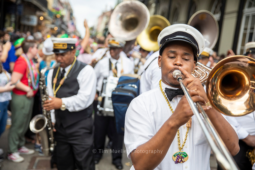 Treme Brass Band members, from left, Revon Andrews and Corey Henry parade with the Krewe of Cork as the krewe marches through the French Quarter. Founded in 2000, the Krewe of Cork has grown into a world famous Mardi Gras parade with a celebration of wine, food and fun.