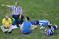 a Group of Sheffield Wednesday fans sitting on the grass outside Wembley Stadium before k/o. Skybet football league Championship play off final match, Hull city v Sheffield Wednesday at Wembley Stadium in London on Saturday 28th May 2016.<br /> pic by John Patrick Fletcher, Andrew Orchard sports photography.