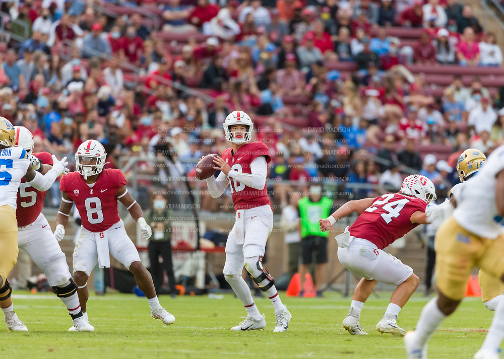PALO ALTO, CA - SEPTEMBER 26: Tanner McKee #18 of the Stanford Cardinal plays in an NCAA Pac-12 college football game against the UCLA Bruins on September 26, 2021 at Stanford Stadium in Palo Alto, California; also visible is Nathaniel Peat #8 and Jay Symonds #24.  (Photo by David Madison/Getty Images)