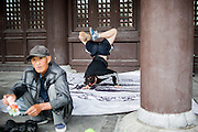 A Chinese man performs breakdance in Datong, China, July 23, 2014.<br /> <br /> Food and games are a real pleasure for the life of Chinese community. <br /> At home, in the streets, at the park or in restaurants, the chance to find someone eating or playing is considerably high.<br /> <br /> © Giorgio Perottino