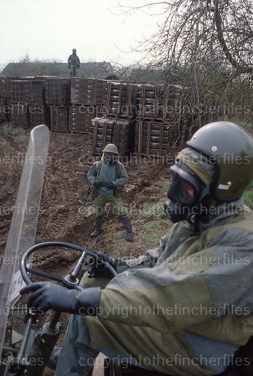 British soldiers wearing NBC suits while on NATO exercises in West Germany late 1970's. Photograph by Terry Fincher