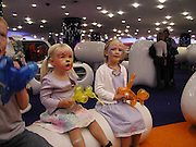 Willow and Lili Bidwell. party in aid of the N.S.P.C.C. at the new children's dept. in Selfridges. 3 rd floor. Oxford St. London. 8 September 2002.  © Copyright Photograph by Dafydd Jones 66 Stockwell Park Rd. London SW9 0DA Tel 020 7733 0108 www.dafjones.com