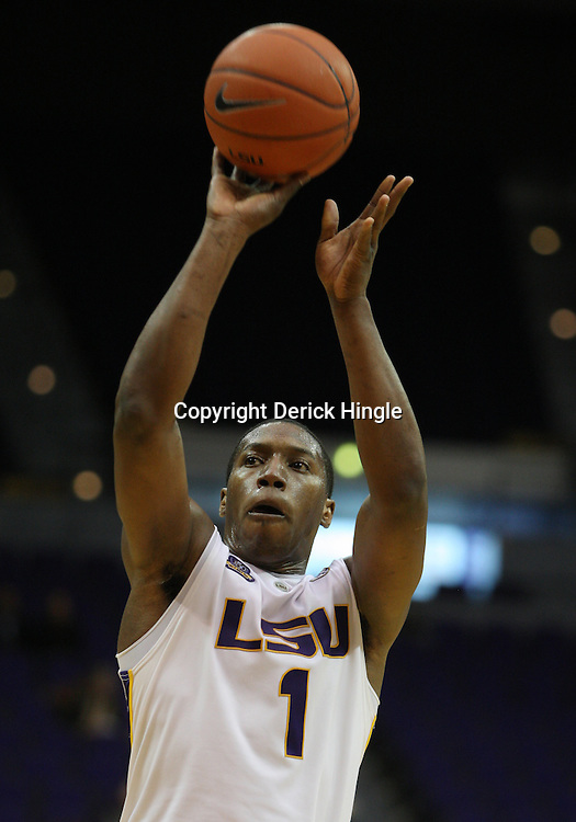 Jan 04, 2010; Baton Rouge, LA, USA; LSU Tigers forward Tasmin Mitchell (1) shoots against the McNeese State Cowboys during the second half at the Pete Maravich Assembly Center. LSU defeated McNeese State 83-60.  Mandatory Credit: Derick E. Hingle-US PRESSWIRE