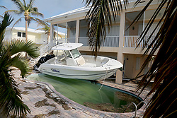 September 13, 2017 - Duck Key, Florida, U.S. - A boat sits over a swimming pool at a home in Duck Key that sustained significant damage from Hurricane Irma.  (Credit Image: © Sun-Sentinel via ZUMA Wire)