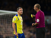 Everton's Phil Jagielka is shown a yellow card by Referee Robert Madley<br /> <br /> Photographer Ashley Western/CameraSport<br /> <br /> The Premier League - Chelsea v Everton - Saturday 5th November 2016 - Stamford Bridge - London<br /> <br /> World Copyright © 2016 CameraSport. All rights reserved. 43 Linden Ave. Countesthorpe. Leicester. England. LE8 5PG - Tel: +44 (0) 116 277 4147 - admin@camerasport.com - www.camerasport.com