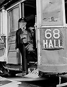 Y-480506-1.  conductor changing 68 Hall sign to Mt. Hall.