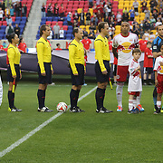 Tim Cahill's son, 11-year-old aspiring artist Kyah Cahill, sings the US national anthem at Red Bull Arena as Tim Cahill, (right), watches before the New York Red Bulls Vs Chicago Fire, Major League Soccer regular season match at Red Bull Arena, Harrison, New Jersey. USA. 10th May 2014. Photo Tim Clayton