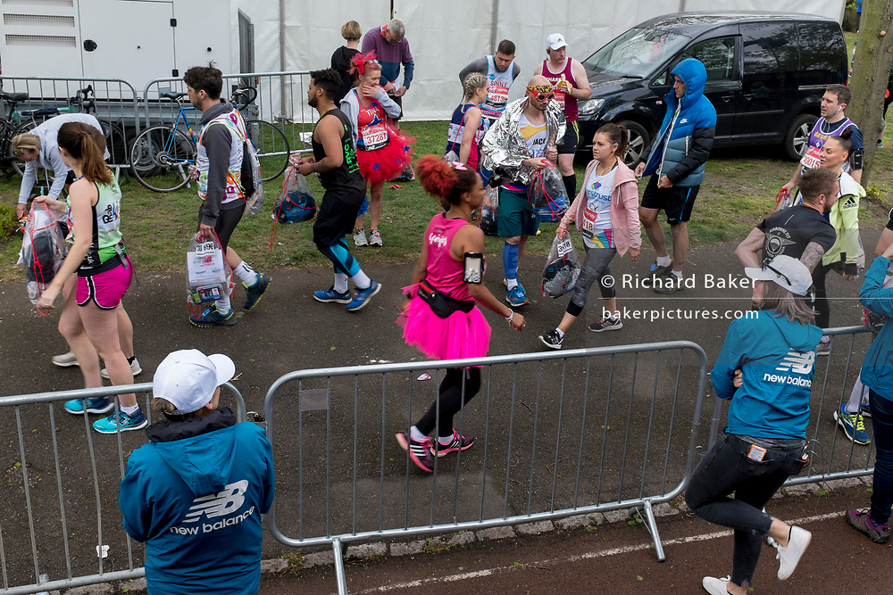 Local London park run volunteers load runners' bags into the lorries in Greenwich Park before the start of the 2019 London Marathon, on 28th April 2019, in London, England