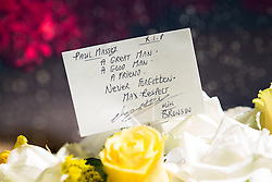 "© Licensed to London News Pictures . 28/08/2015 . Salford , UK . Flowers and tribute on one of the hearses signed "" Max Respect "" and "" Alias Bronson "" . The funeral of Paul Massey at St Paul's CE Church in Salford . Massey , known as Salford's "" Mr Big "" , was shot dead at his home in Salford last month . Photo credit : Joel Goodman/LNP"