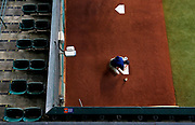 A member of the field crew cleans up a home plate in the bullpen before the game between the Chicago White Sox and the Houston Astros at Minute Maid Park on May 21, 2019 in Houston, Texas. (Photo by Katelyn Mulcahy)
