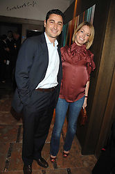 CEM & CAROLINE HABIB at a party to celebrate the publication of Lisa B's book 'Lifestyle Essentials' held at the Cook Book Cafe, Intercontinental Hotel, Park Lane London on 10th April 2008.<br />