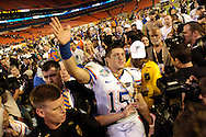 Broward, Miami Gardens, Fl. 1/8/2009 -2009 FedEx BCS NATIONAL CHAMPIONSHIP- Florida quarterback Tim Tebow comes off the field after winning the FedEx BCS National Championship game at Dolphin Stadium on January 8, 2009 in Miami, Florida.  PHOTOS  25 OF IMAGES STAFF MICHAEL SPOONEYBARGER..
