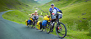 Cyclists on roadway through Wrynose Pass in the Dudden Valley part of the Lake District National Park, Cumbria, UK