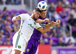 April 8, 2018 - Orlando, FL, U.S. - ORLANDO, FL - APRIL 08: Portland Timbers defender Bill Tuiloma (25) vs Orlando City midfielder Will Johnson (4) challenging for a header during the MLS soccer match between the Orlando City FC and the Portland Timbers at Orlando City SC on April 8, 2018 at Orlando City Stadium in Orlando, FL. (Photo by Andrew Bershaw/Icon Sportswire) (Credit Image: © Andrew Bershaw/Icon SMI via ZUMA Press)