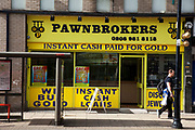 Pawnbrokers shop on Roman Road in East London. A pawnbroker is an individual or business (pawnshop or pawn shop) that offers secured loans to people, with items of personal property used as collateral. The word pawn is derived from the Latin pignus, for pledge, and the items having been pawned to the broker are themselves called pledges or pawns, or simply the collateral. If an item is pawned for a loan, within a certain contractual period of time the pawner may purchase it back for the amount of the loan plus some agreed-upon amount for interest.