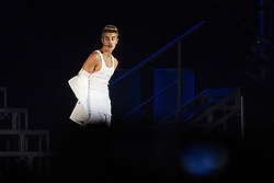 "© Licensed to London News Pictures . FILE PICTURE DATED 21/02/2013 of Canadian pop star JUSTIN BIEBER removing his jacket whilst on stage at the Manchester Arena , UK , on the opening night of his UK "" Believe "" tour , as a spokeswoman last night (7th March) reported Bieber had to take an unscheduled break during a show at the O2 Arena last night (7th March). Bieber was said to have fainted and had to be treated by doctors with oxygen before returning to the stage . Photo credit : Joel Goodman/LNP"