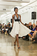 Halter-top dress with white pleated skirt and black and white halter top. By Carmen Marc Valvo at the Spring 2013 Fashion Week show in New York.