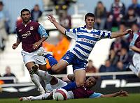 Photo: Olly Greenwood.<br />West Ham United v Reading. The Barclays Premiership. 01/10/2006. West Ham's Danny Gabbidon sends Reading's James Harper flying
