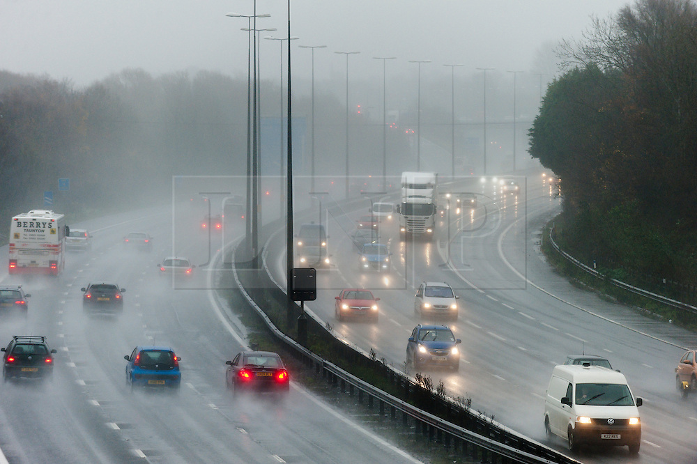 © Licensed to London News Pictures. 10/12/2016. Bristol, Somerset, UK. Rain, surface water and reduced visibility makes driving conditions dangerous on the M5 motorway near Bristol. Photo credit: Graham M. Lawrence/LNP