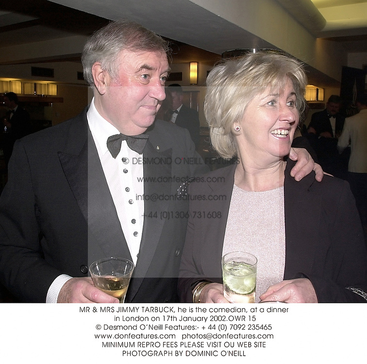 MR & MRS JIMMY TARBUCK, he is the comedian, at a dinner in London on 17th January 2002.	OWR 15