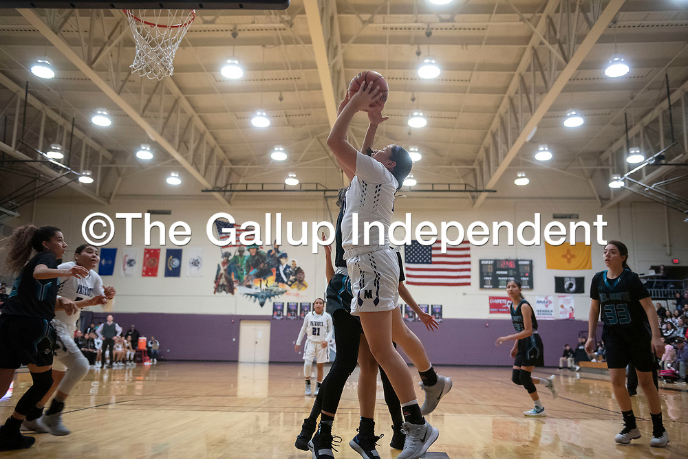 Miyamura's Destiny Bryan (23) takes a shot under the  basket against Del Norte Friday night at Miyamura High School in Gallup.