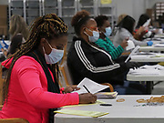 Election workers process mail-in absentee ballots at Gwinnett County Voter Registration & Elections.