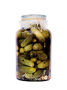 A jar of pickled gherkins prepared for the winter by a peasant farmer, Botiza, Maramures, Romania