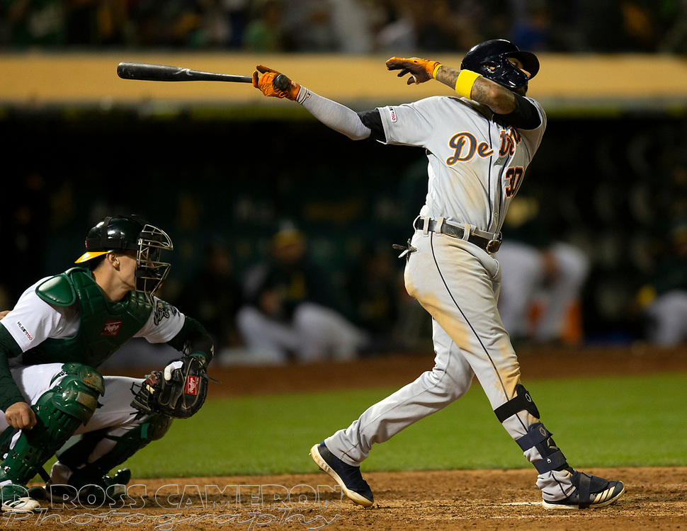 Sep 7, 2019; Oakland, CA, USA; Detroit Tigers Harold Castro (30) swings and misses for the final out of a baseball game against the Oakland Athletics at Oakland Coliseum. Mandatory Credit: D. Ross Cameron-USA TODAY Sports