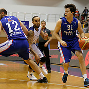 Istanbul BSB's Zack Wright (C) and Anadolu Efes's Thomas Heurtel (R) during their Turkish Basketball League match Istanbul BSB between Anadolu Efes at Cebeci Arena in Istanbul Turkey on Monday 09 March 2015. Photo by Aykut AKICI/TURKPIX